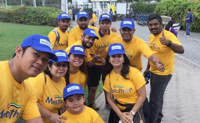 selfie, Cabot employees in yellow event t-shirts and blue caps