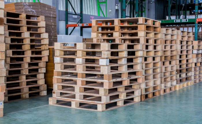 several stacks of wooden pallets which are used for deliveries